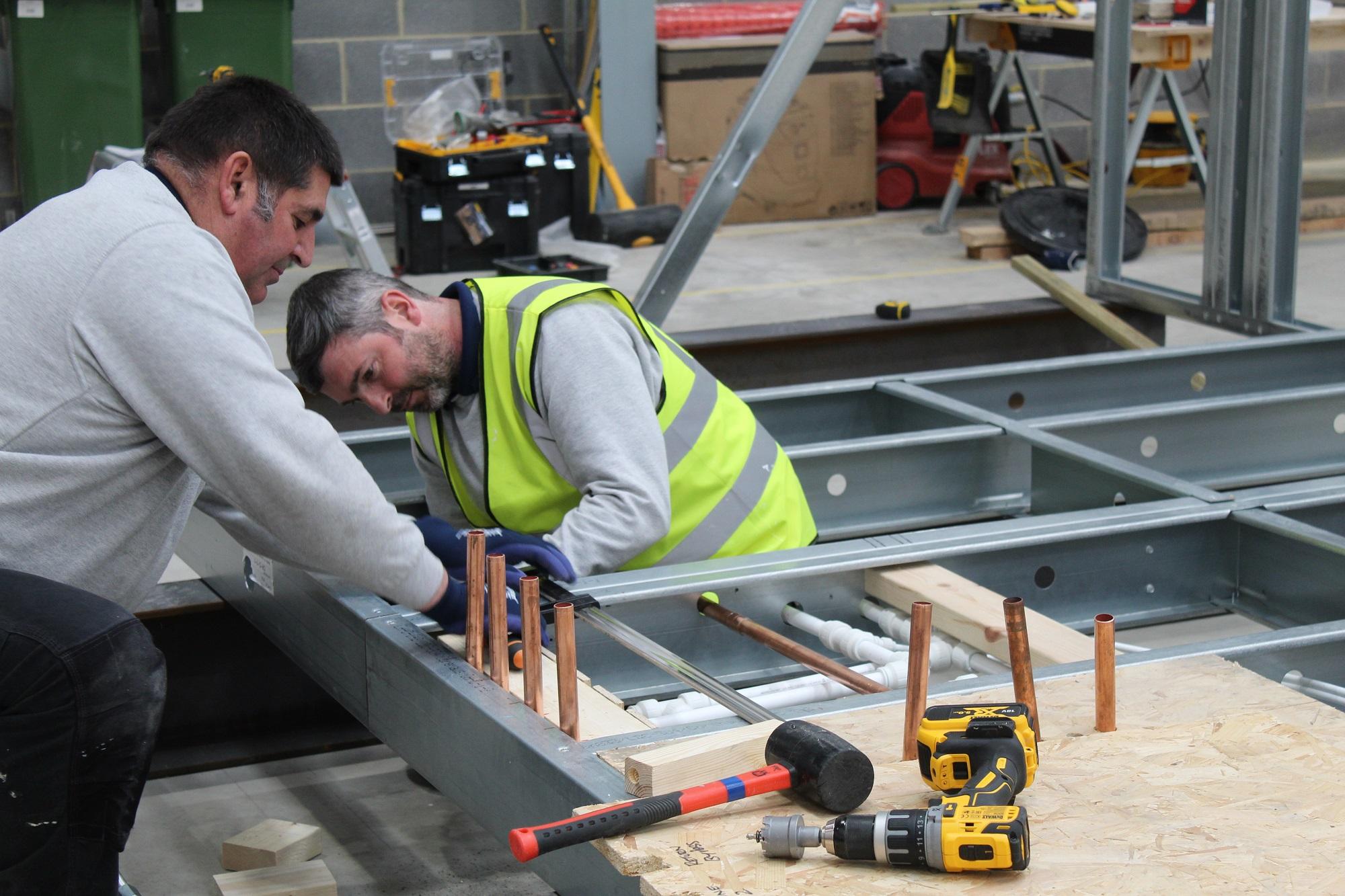 CoreHaus workers working on modular housing unit