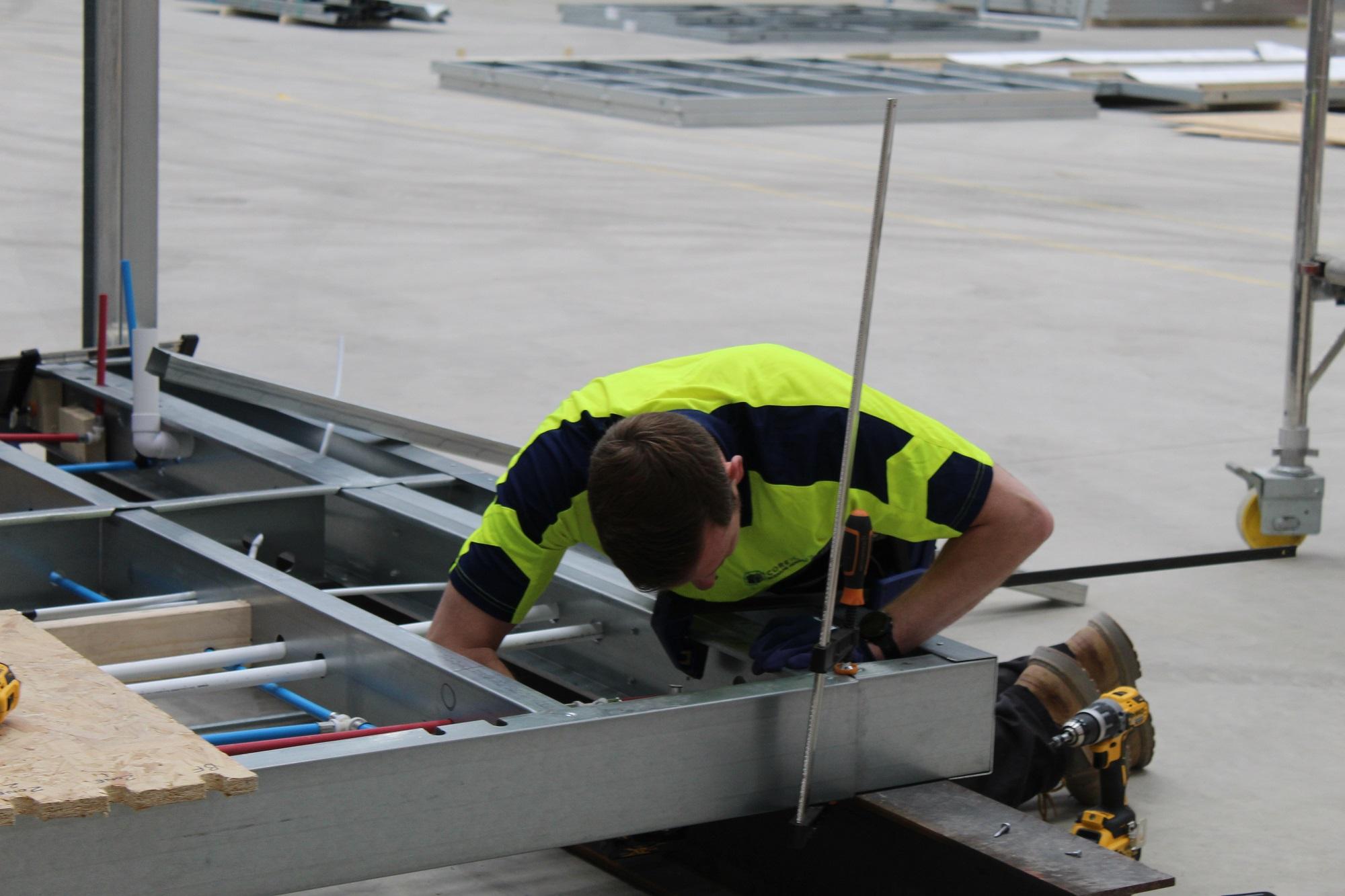 CoreHaus worker constructing modular housing unit